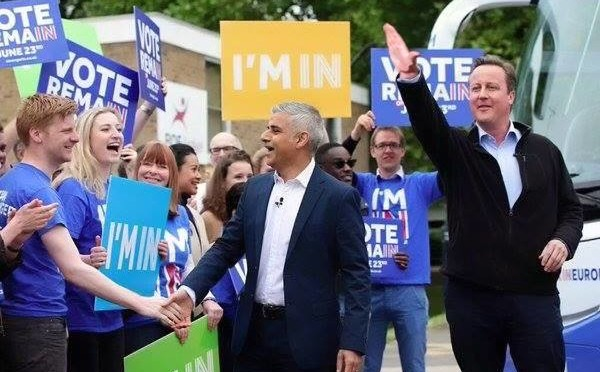 Khan photographed sharing platform with extremist